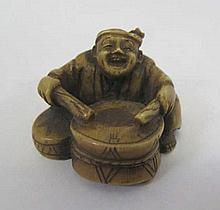 Antique netsuke of a man with a drum signed 3.8cms dia