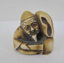 Meiji Japanese netsuke of a seated man signed 4cms ht