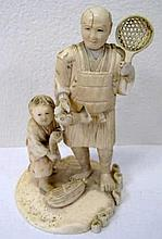 Meiji Ivory carving of a Fisherman and boy holding fish and scoop signed to