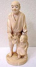 Meiji Ivory carving of a man with boy signed to base with red seal measures
