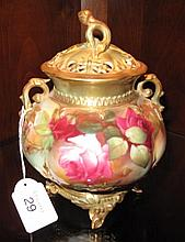 Royal Worcester gilded rose footed lidded vase