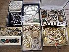 Assorted costume jewellery includes necklaces, bracelets, gems, beaded purs