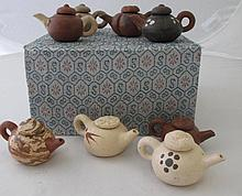 Boxed collection miniature Yixing teapots (8)