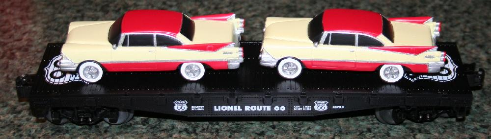 Lionel Trains Route 66 Flatcar With 2 Cream/Red Luxury Coupes #6-17536 MIMB