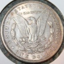 Lot 72: 1889 Morgan Silver Dollar Coin AU-50 Or Better
