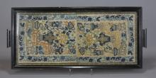 A 19/20th century embroidery inside a wooden tray