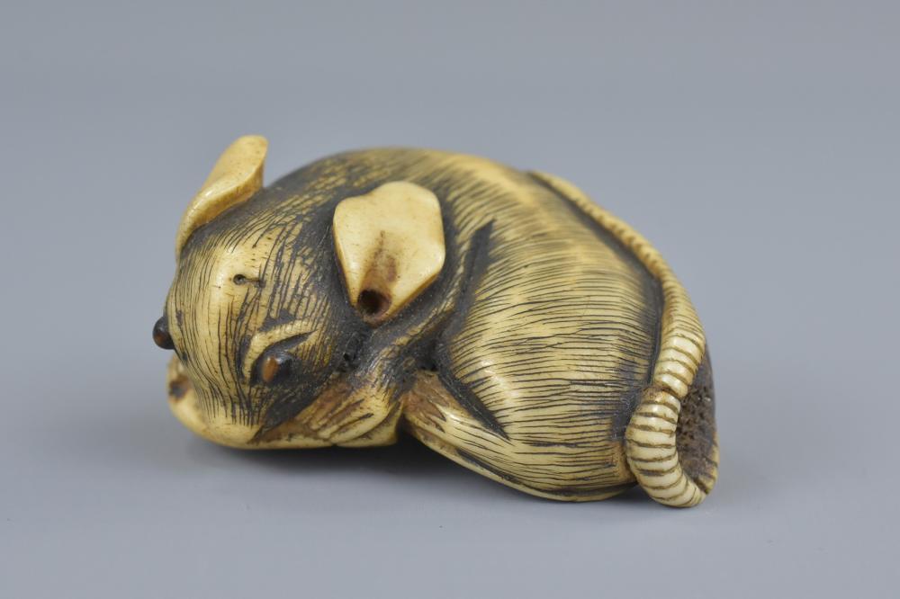 A Japanese Carved Bone Netsuke
