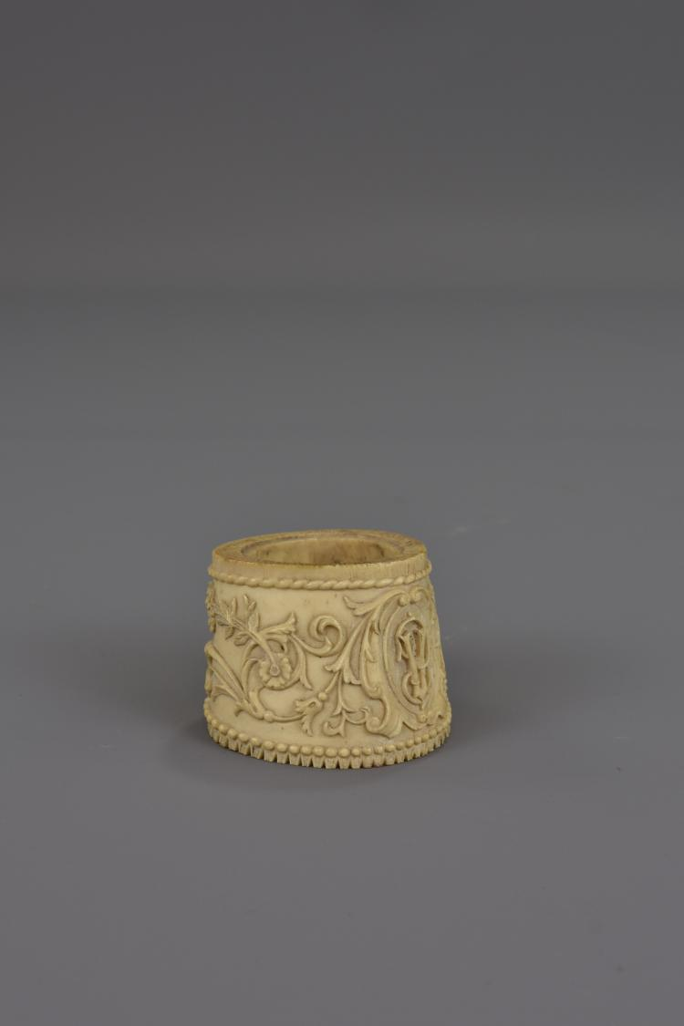 An Asian Carved Bone Napkin Ring