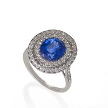 Blue Sapphire, Diamond and Platinum 'Halo' Ring