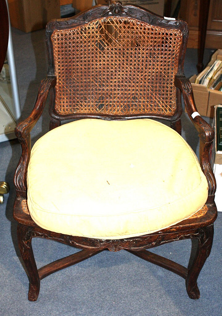 AN EARLY 19TH CENTURY FRENCH BEECHWOOD AND CANE