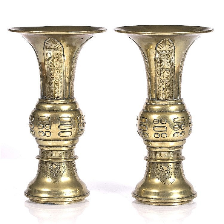 A pair of Chinese bronze gu shaped vases