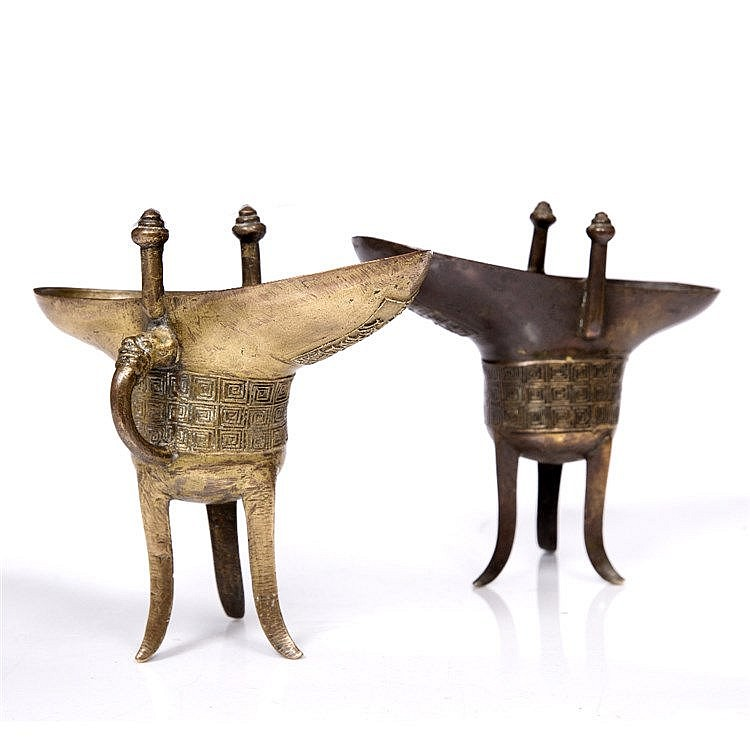 A pair of Chinese bronze jue vessels