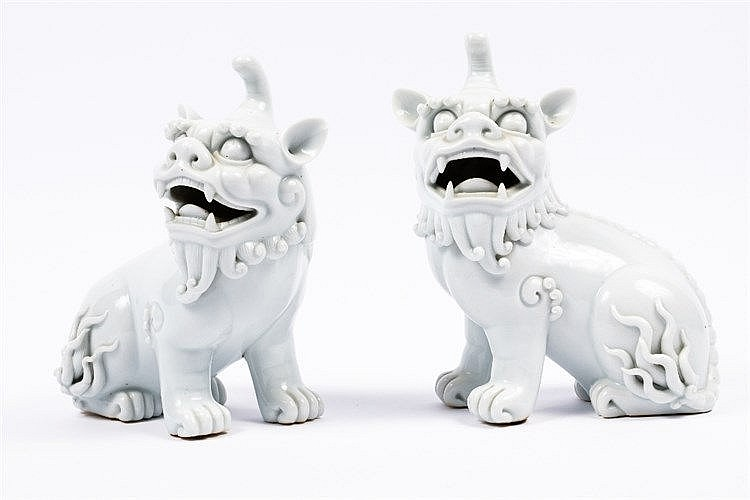 A Pair of Chinese blanc de chine temple dogs