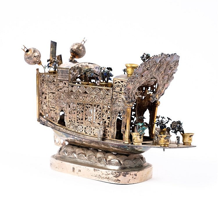 A Chinese white metal model junk