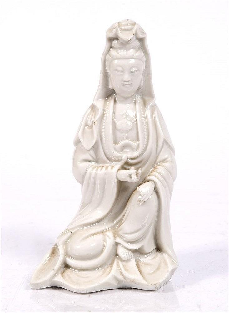 A Chinese Dehua figure of a seated Guanyin