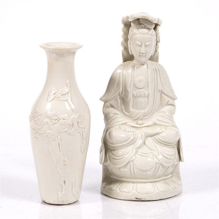 A Chinese Dehua figure of a seated Guanyin
