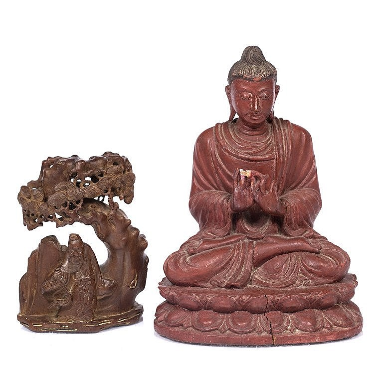 A Chinese carved wood kneeling Buddha