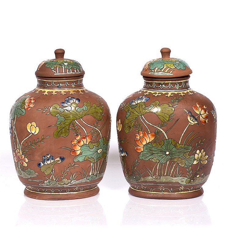 A pair of Chinese Xin stone ware vases and covers