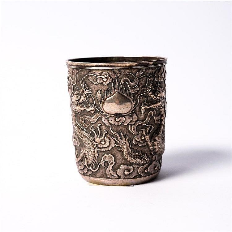 A Chinese white metal beaker