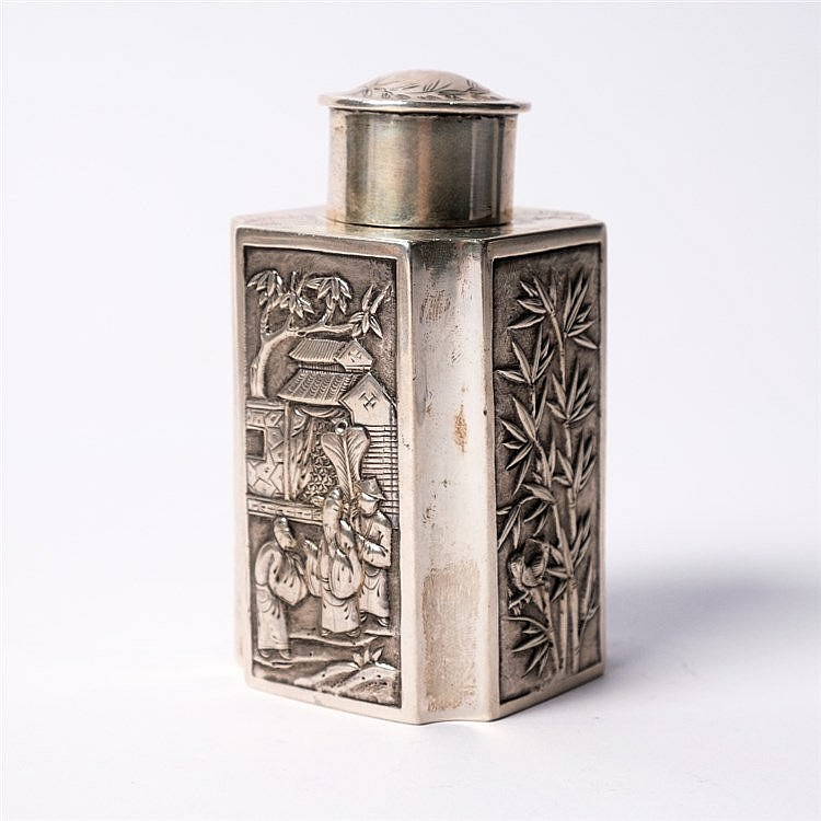 A Chinese white metal tea canister