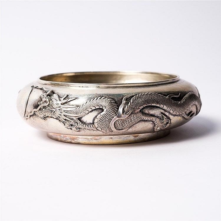 A Chinese white metal bowl
