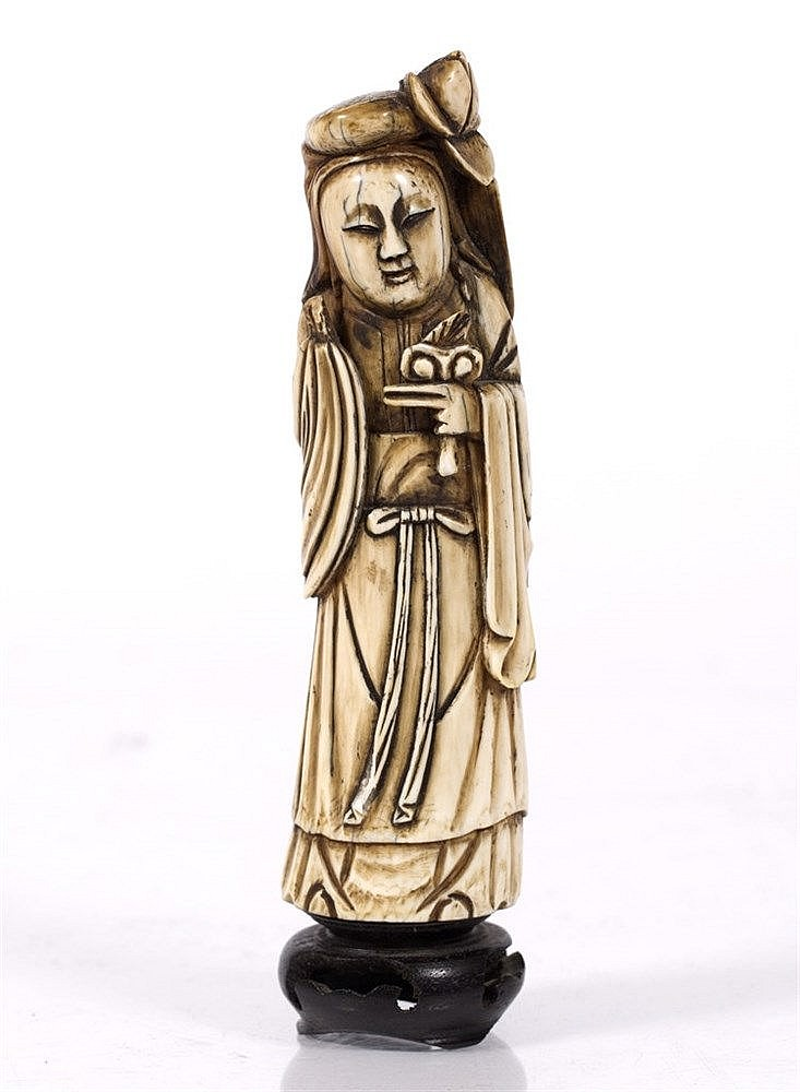 A Chinese ivory tusk end figure of Ho Sien-Ku