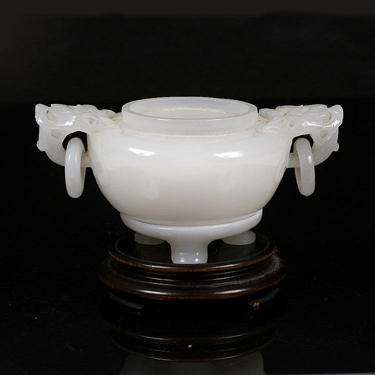 A fine Beijing white glass emulating jade two handled ting
