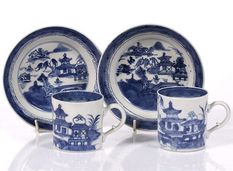 A pair of Chinese blue and white export cups and saucers