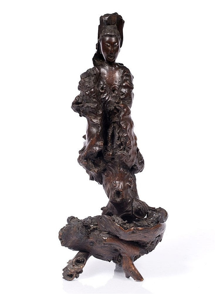 A Chinese carved naturalistic wood model of Guanyin