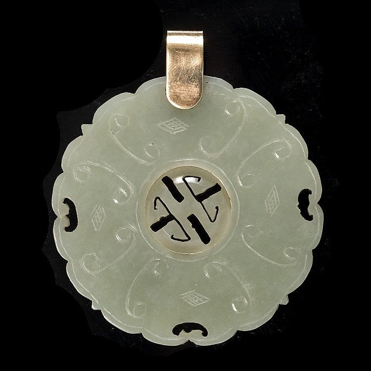 A Chinese green jade medallion shaped pendant