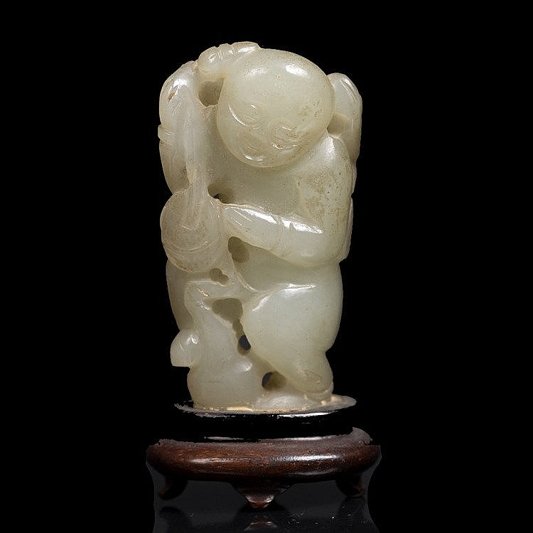 A Chinese greyish white jade pebble