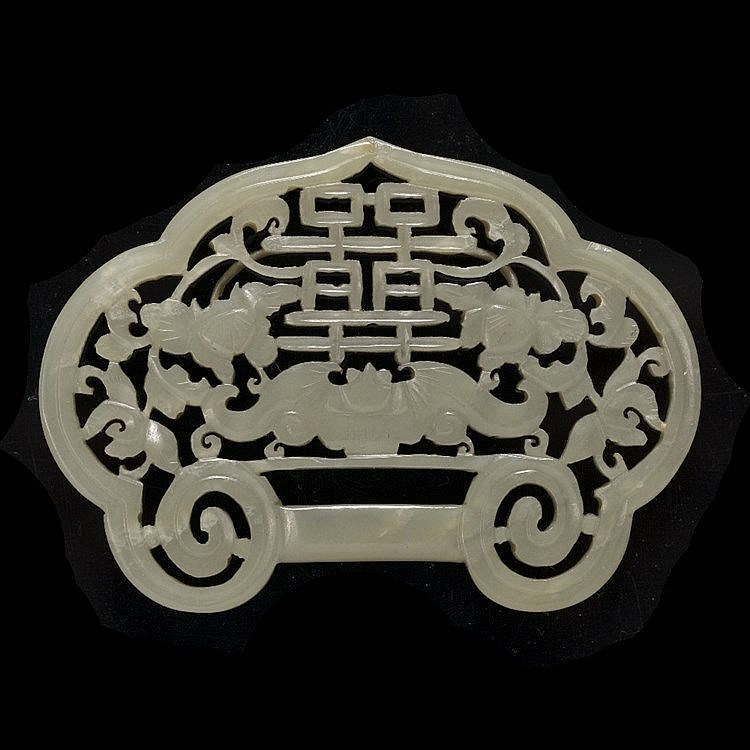 A Chinese green jade belt buckle shaped pendant