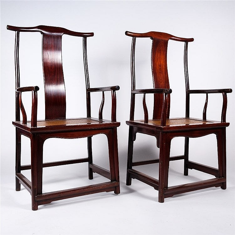 A pair of Chinese 17th Century style hard wood chairs