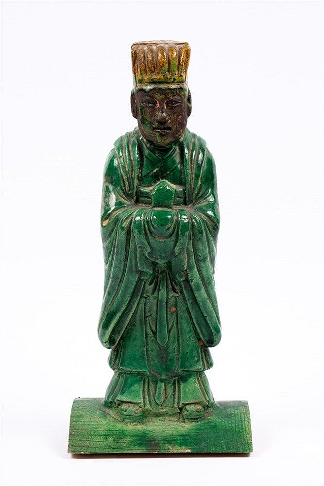 A Chinese tile guardian figure