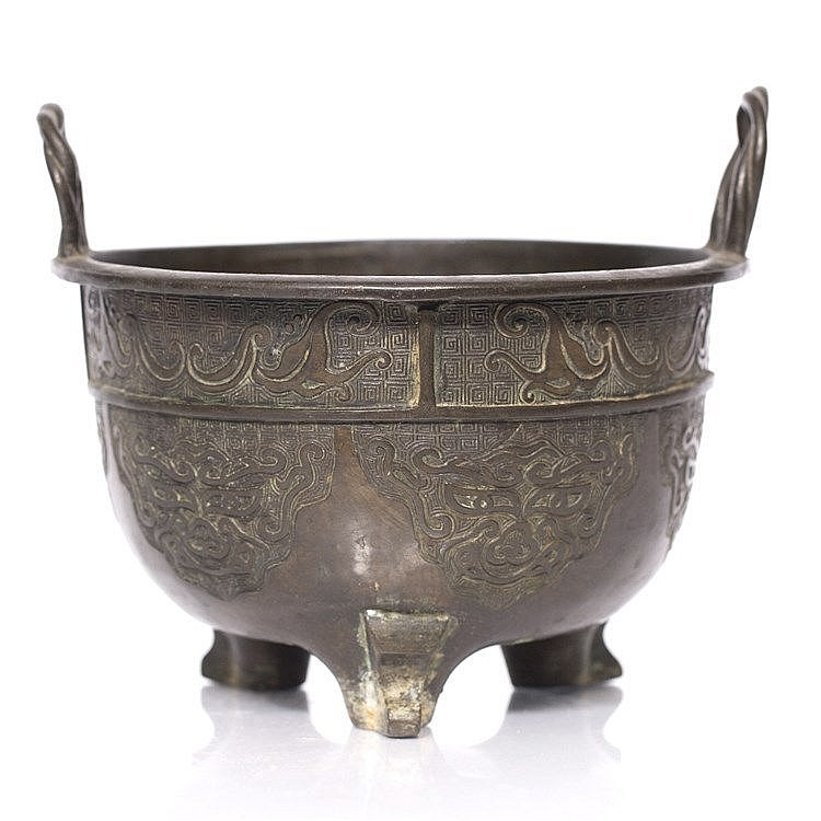 A Chinese archaic bronze two handled censer