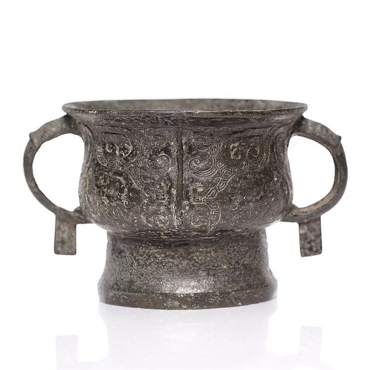 A Chinese bronze archaic two handled censer