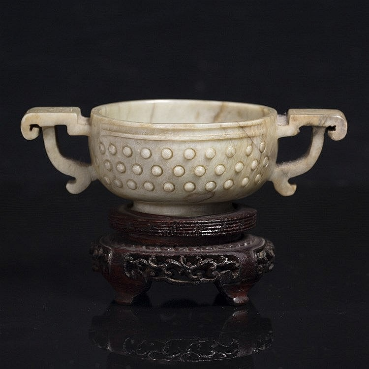 A Chinese brown striated grey jade archaic bronze style two handled wine cup