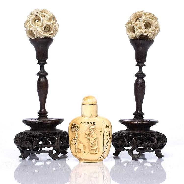A Chinese pair of ivory pierced and carved concentric balls