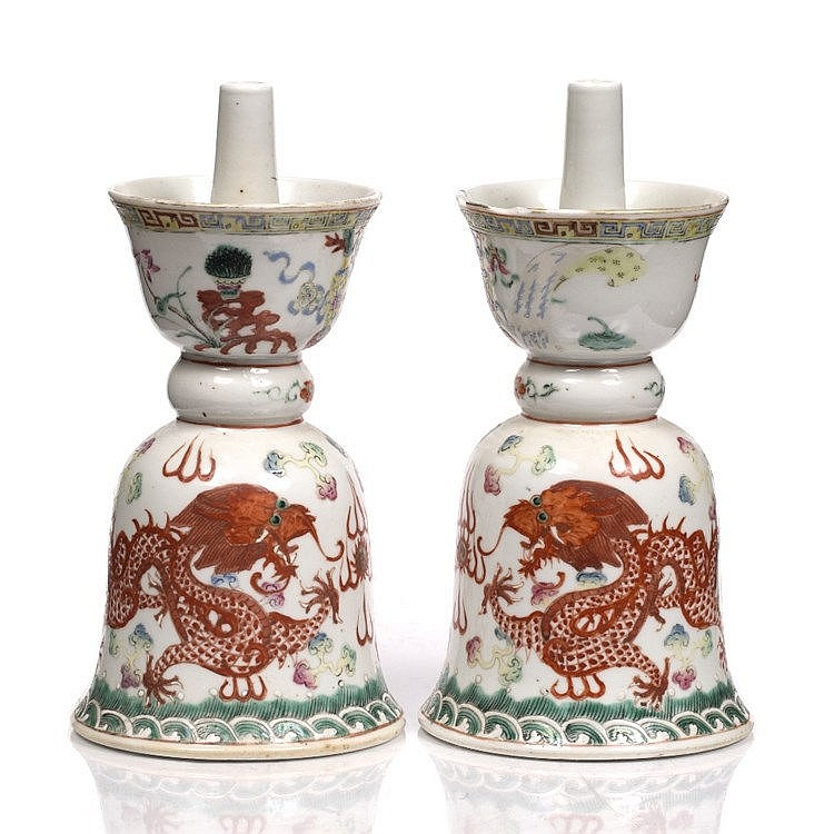 A pair of Chinese porcelain inverted candle holders