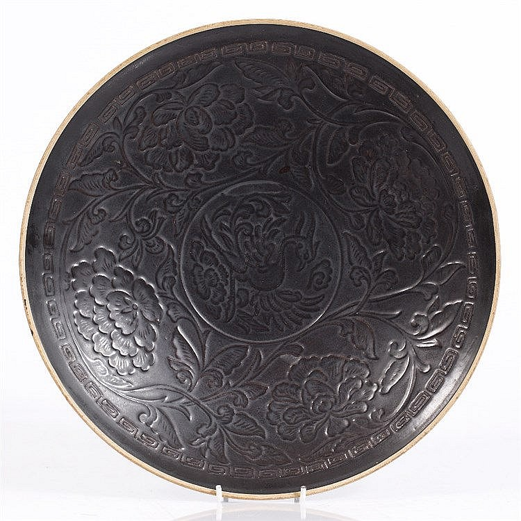 A large Chinese 'black' Ding ware dish