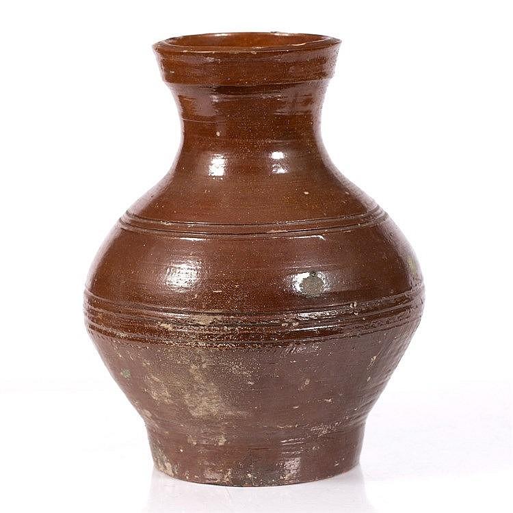 A large persimmon-glazed baluster vase