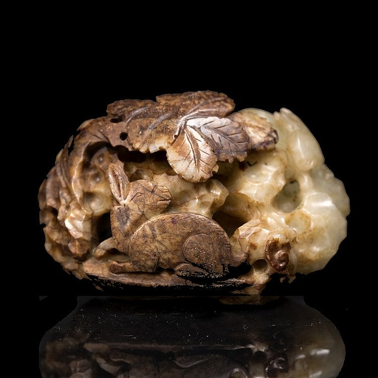 A Chinese white and brown jade pebble