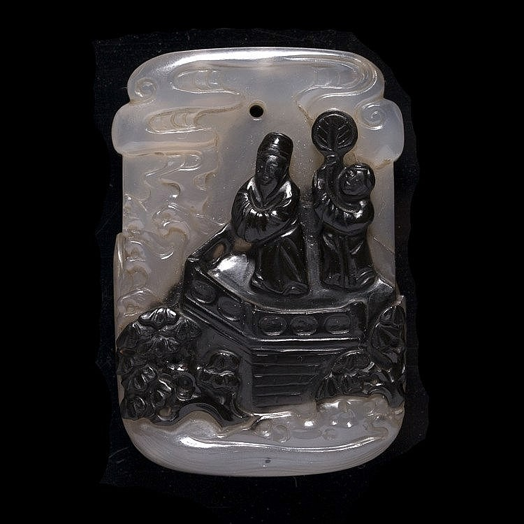 A Chinese translucent greyish and black infused agate plaque pendant