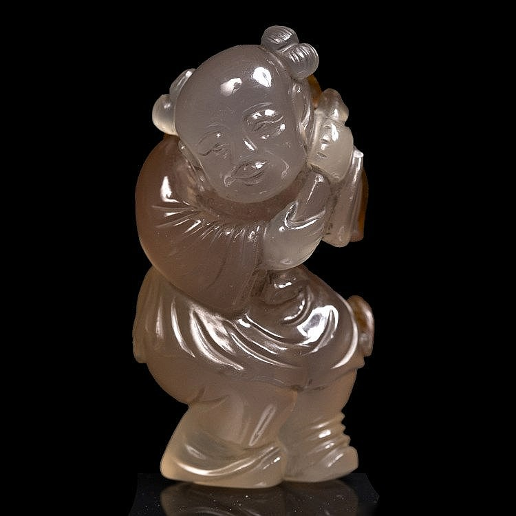 A Chinese brown splashed pale translucent figure of a youth