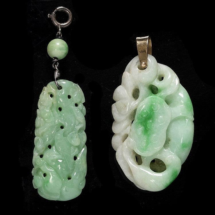 A Chinese white and emerald green jadeite pendant