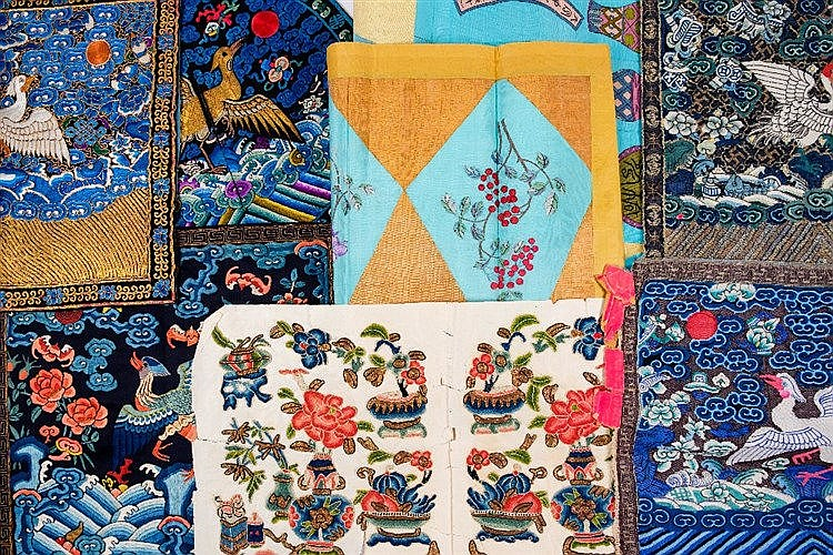 A large collection of Chinese embroidered silks