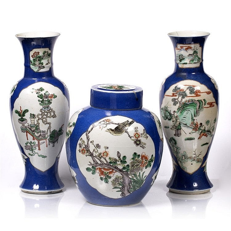 A garniture of three Chinese famille rose vases
