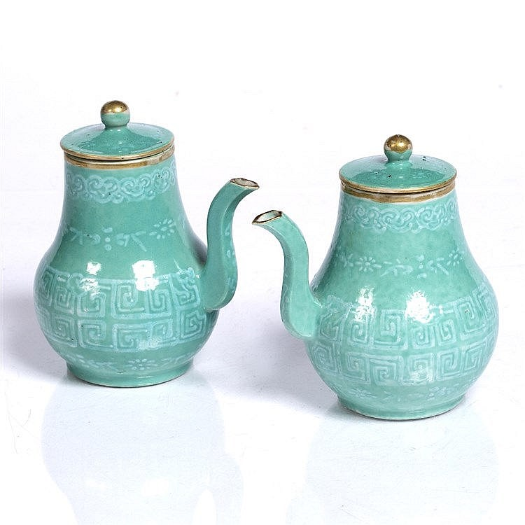 A pair of Chinese turquoise wine pots and covers
