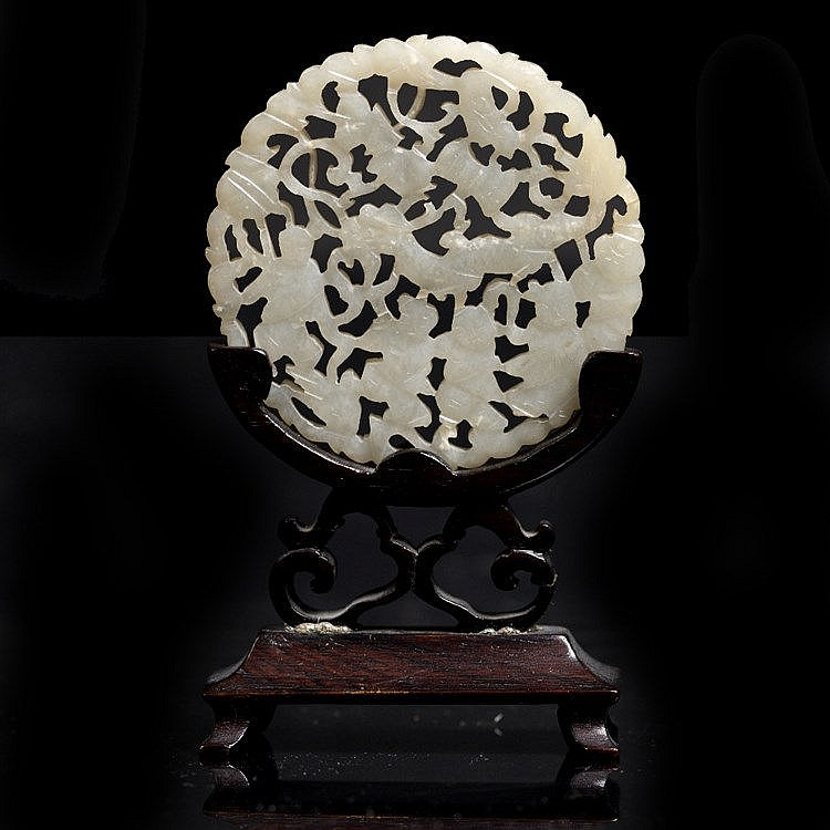 A Chinese white jade pierced and carved medallion