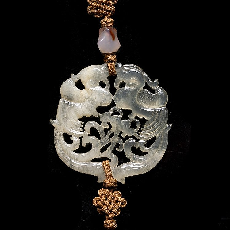 A Chinese pierced and carved translucent and opaque agate pendant